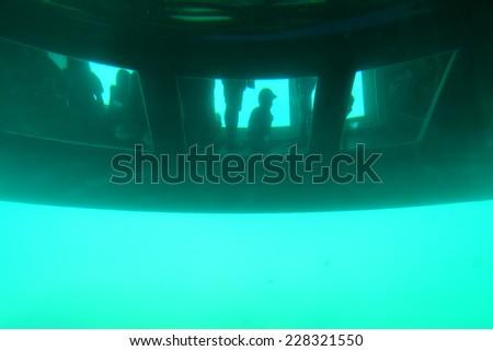 Glass bottomed catamaran below the water - stock photo