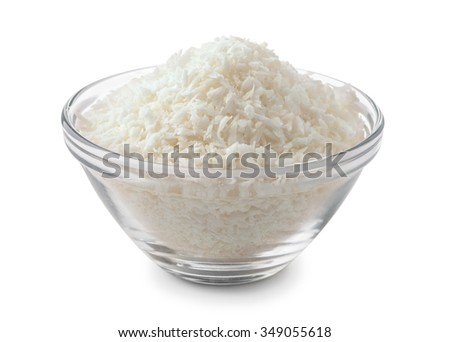 Glass bowl of coconut shavings isolated on white - stock photo