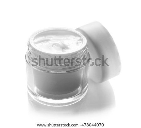 Glass bowl of facial cream isolated on white