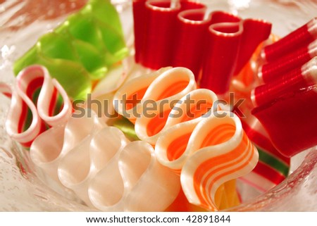 Glass bowl of ribbon candy - stock photo