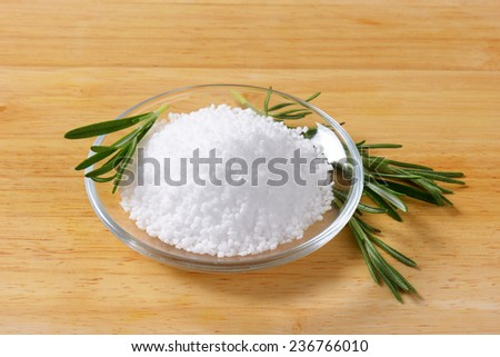 glass bowl of sea salt with sprig of thyme