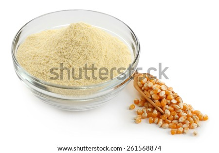 Glass bowl with flour and corn grains isolated on white - stock photo