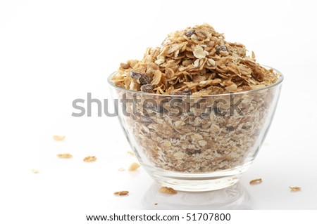 Glass bowl with muesli isolated on white background. - stock photo