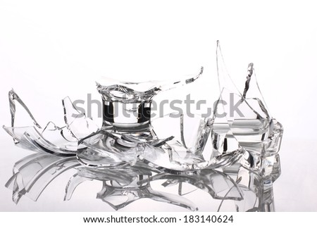 glass broken vase with fragments isolated on white background - stock photo
