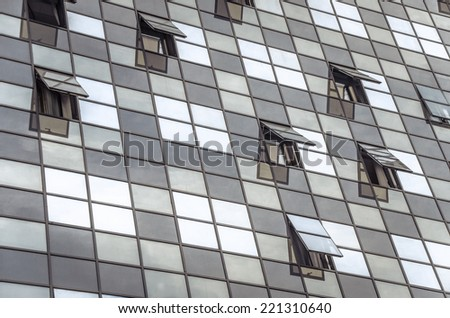 Glass building with open windows. - stock photo