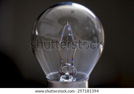 Glass Bulb over dark background - stock photo