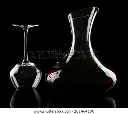 Glass carafe of wine on dark background - stock photo