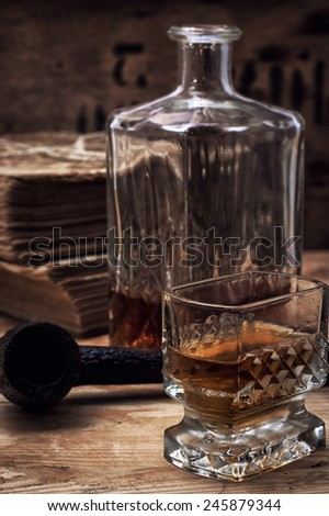 glass carafe with alcoholic drink of whiskey vintage style