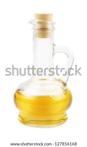 Glass carafe with vegetable oil isolated on white background - stock photo