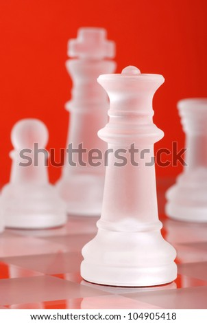 glass chess photographed up close with the orange background - stock photo