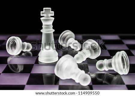Glass chess pieces - stock photo