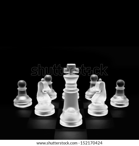 glass chess pieces on black background