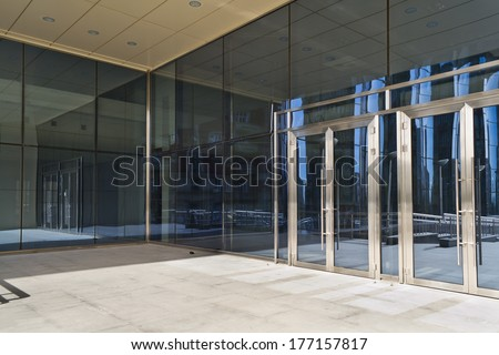 Glass closed doors of the entrance in modern building