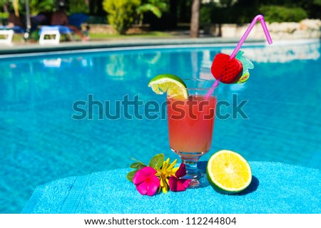 Glass cocktail drink at the luxury outdoor swimming pool