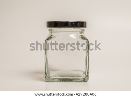 Glass container on white background