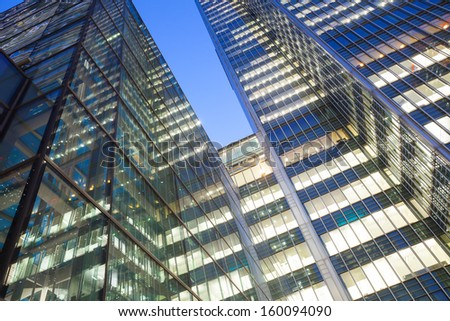 Glass Corporate building Financial Skyscrapers in the Canary Wharf at night, City of London  - stock photo