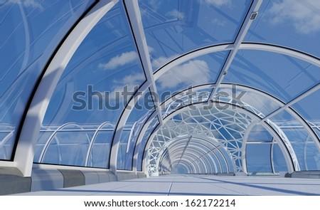 Glass corridor against the blue sky. - stock photo