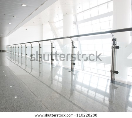 glass corridor in office centre - stock photo