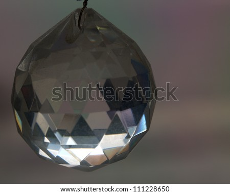 Glass crystal reflects the sun in a shop window - stock photo