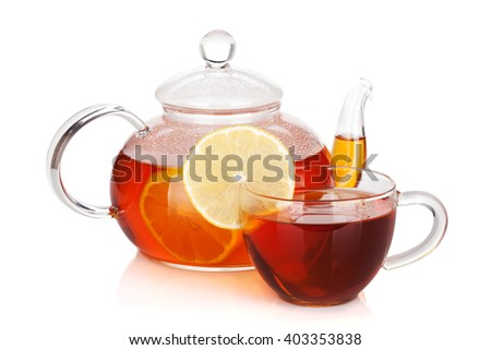 Glass cup and teapot of black tea with lemon. Isolated on white background - stock photo