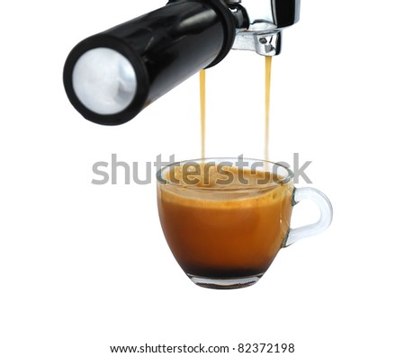 Glass cup of freshly brewed strong coffee pouring   from espresso machine isolated on white background