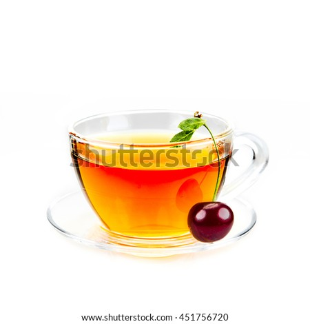 Glass cup of hot cherry tea with fresh cherry on white background