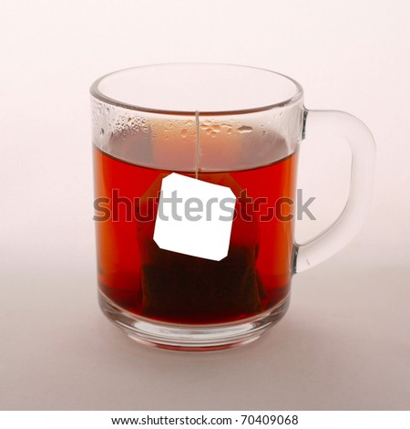 Glass cup of tea on white background.