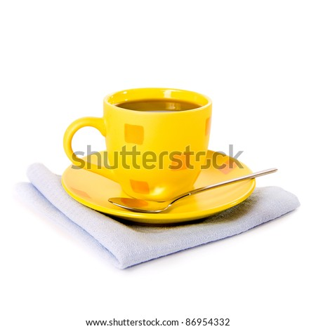Glass cup of tea with lemon on white background