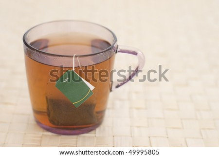 Glass cup with black tea - stock photo