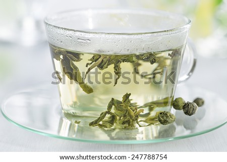 glass cup with green tea  - stock photo