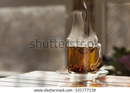 Glass Cup with hot tea.