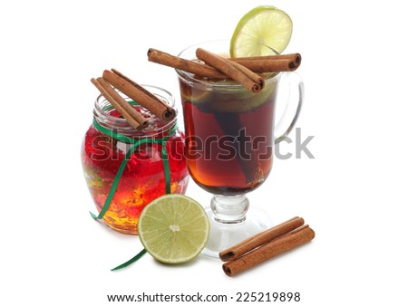 Glass cup with mulled wine on white background - stock photo