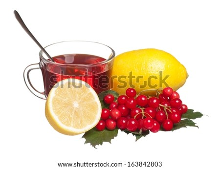 Glass cup with tea and lemon isolated on a white background