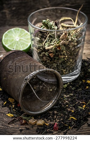glass cup with tea brewing and tea strainer.Selective focus - stock photo