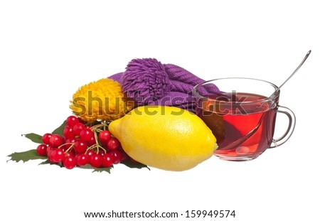 Glass cup with tea, lemon and arrow wood over white background cutout - stock photo
