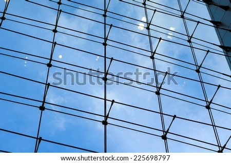 Glass curtain wall with blue sky background