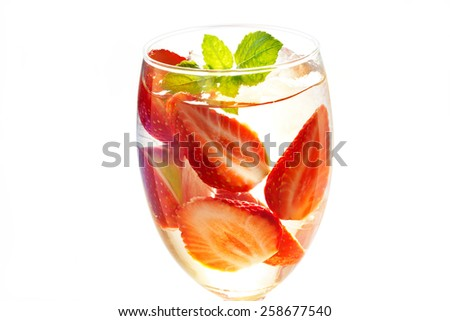 glass delicious refreshing drink of strawberry with mint on on white background, infusioned water, warm color tone - stock photo