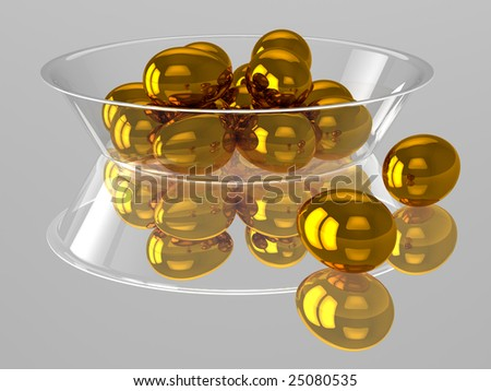 Glass dish with golden eggs - stock photo