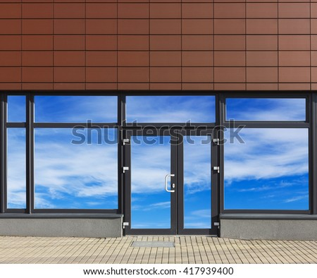 Glass door and windows with sky reflections of new no name office in the modern mass production  building. Collage from several photos.  Glass isolates with patch - stock photo