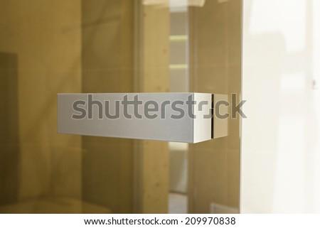Glass door with metal handles  - stock photo