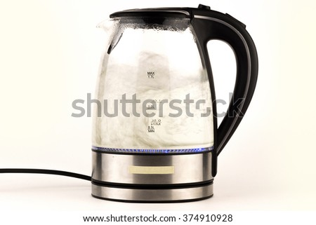 glass electric kettle with boiling water, isolated on white / Electric kettle isolated on white background close up - stock photo