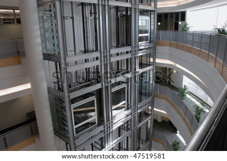 Glass elevators - stock photo