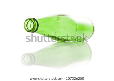 Glass empty green bottle. Isolated on white background - stock photo