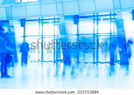 glass entrance door to the building of the airport and passengers - stock photo