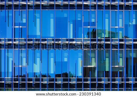 glass facade of a building with solar shading blue: detail - stock photo