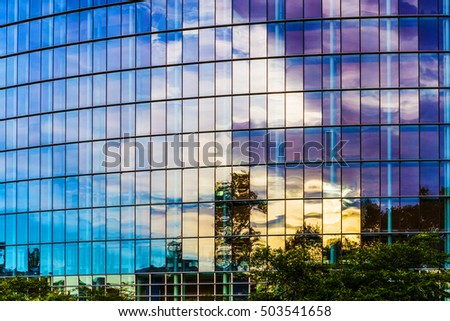 Glass facade of modern building of European Parliament in Strasbourg.