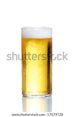 Glass filled up with sparkling beer and head