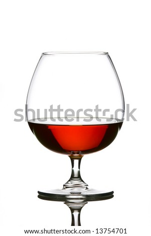 Glass filled with brandy over white background