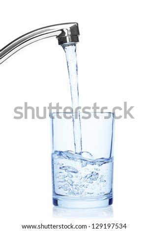 Glass filled with drinking water from tap, isolated on the white background, clipping path included. - stock photo
