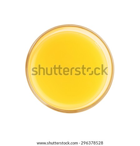 Glass filled with the orange juice isolated over the white background, top view - stock photo